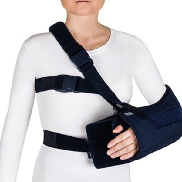 Arm sling with abduction cushion